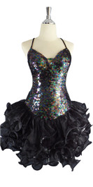 A short handmade sequin dress, in 10mm flat iridescent dark sequins with a black ruffled organza skirt front view