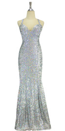 A long handmade sequin dress, in 8mm cupped hologramsilver sequins over white base fabric in a classic flared hemline cut front view
