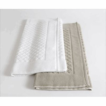 Baksana bamboo bath mats shown in White (left) and Storm (right).
