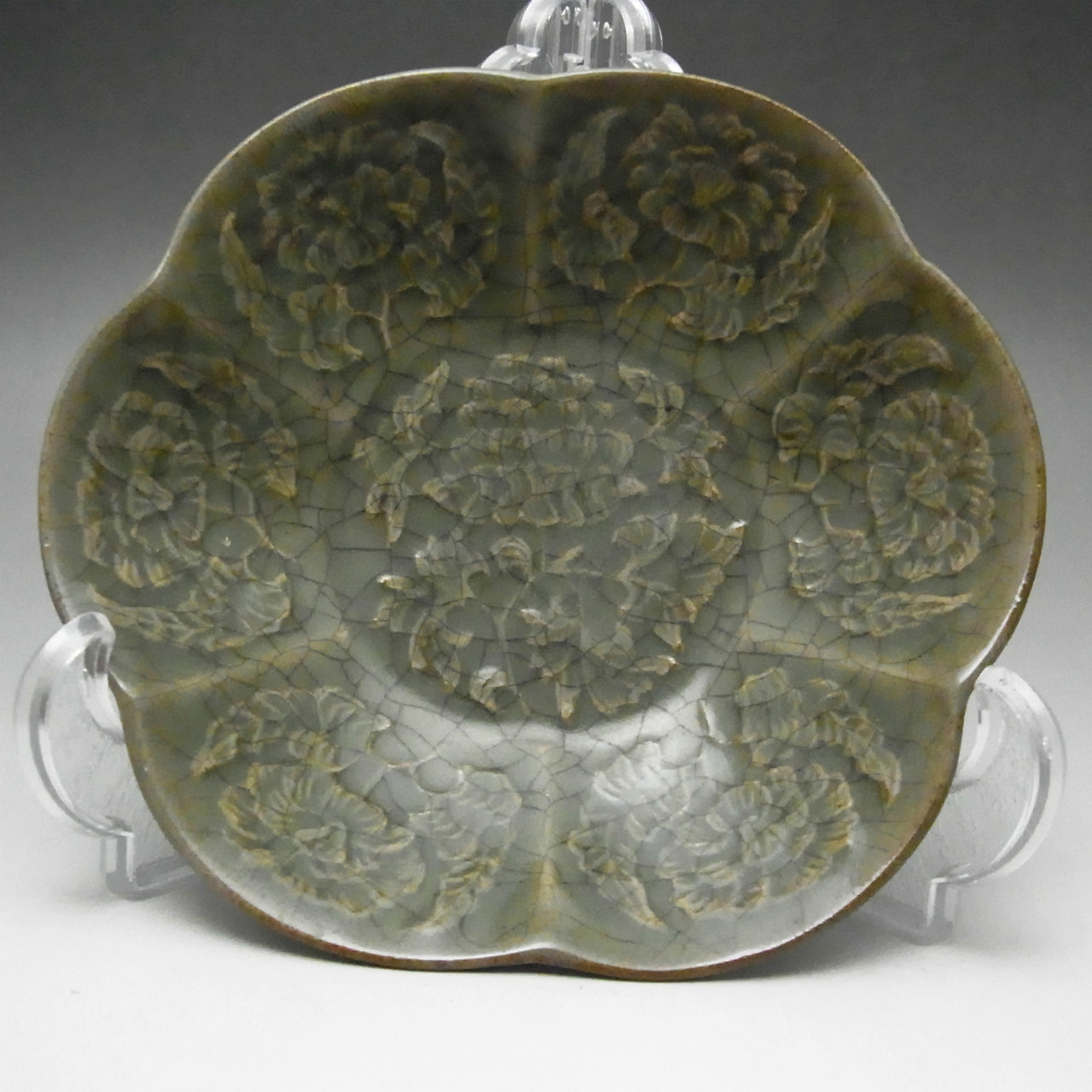 Small antique olive green chinese longquan pottery plate relief
