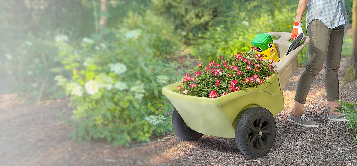 Simplay3 Heavy Duty 2 Wheel Plastic Wheelbarrow with Garden Tool Handle Storage Moves Flowers while Keeping them Level
