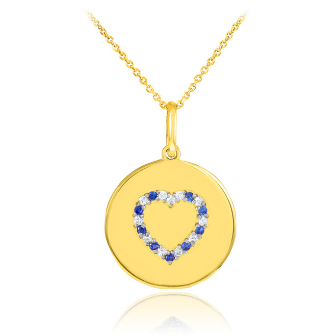 Heart disc pendant necklace with diamonds and sapphire in 14k gold.