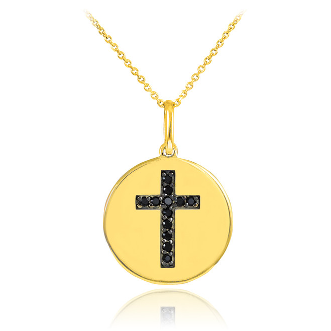 Cross disc pendant necklace with black diamonds in 14k gold.