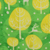 Fabric close-up - Christmas Winter Trees print in Neon Yellow.