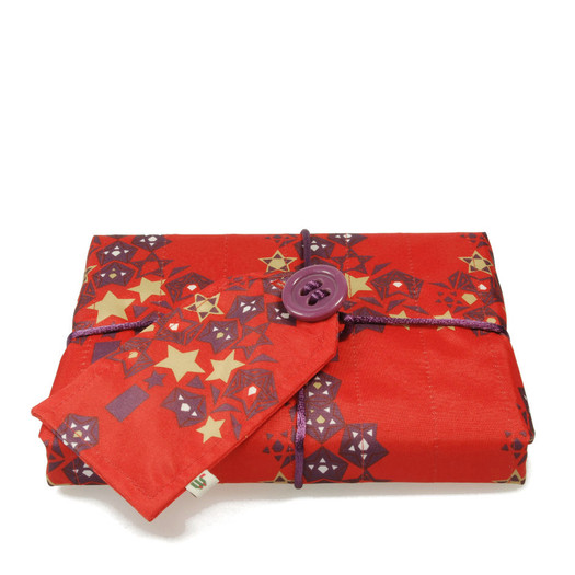 Small 'Crackle' fabric wrap in Cranberry Red.  Shown wrapping a paperback novel.