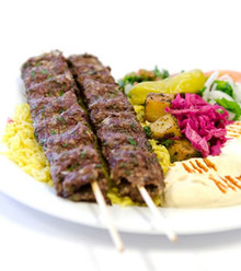Juicy charbroiled ground beef, made with special herbs and spices. Served with hummus, arabic salad, rice and warm pita bread.