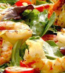 Chargrilled marinated shrimp served over salad tossed with extra virgin olive oil , lemon and garlic sauce.