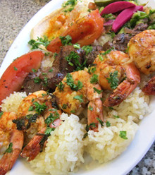Juicy chargrilled marinated with special herbs and spices. served over rice with salad,hummus and garlic sauce and pita