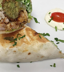 Sizzling marinated chicken shawarma, cooked on a vertical spinning grill and falafel Served on a wrap with lettuce, tomatoes, pickles and our special garlic sauce.