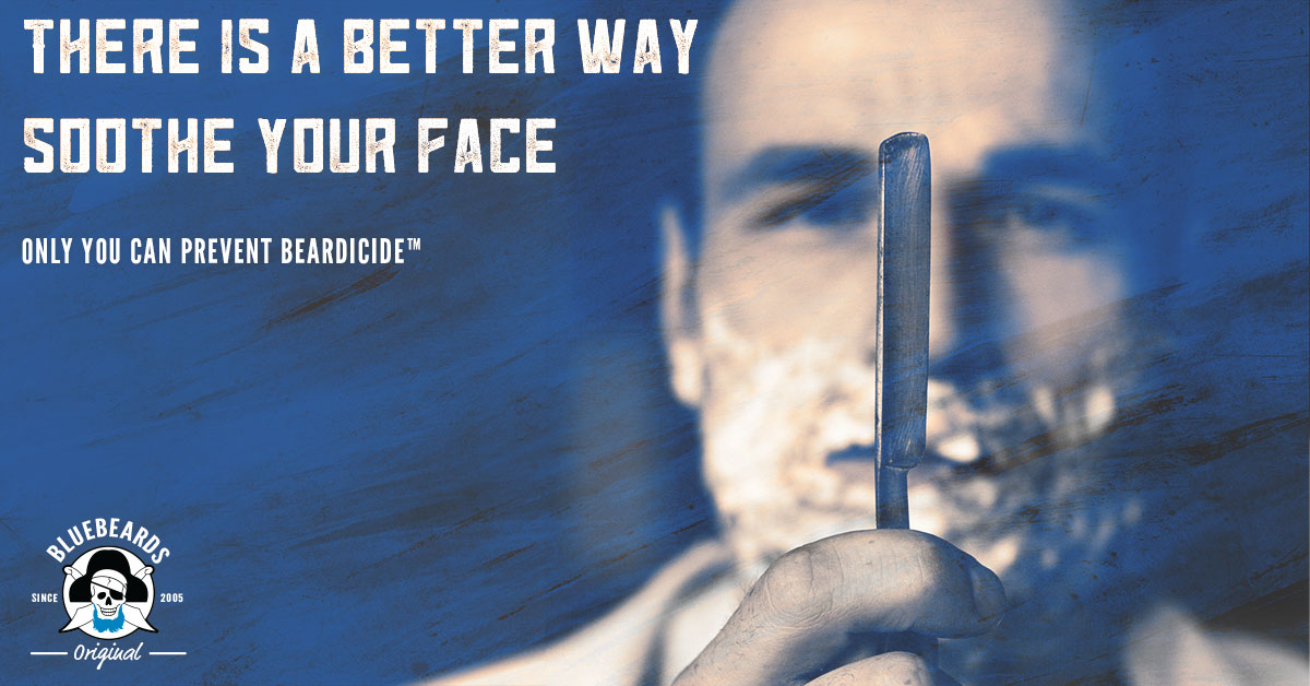 A man with his beard already lathered considers whether to go through with it while looking at a straight razor.
