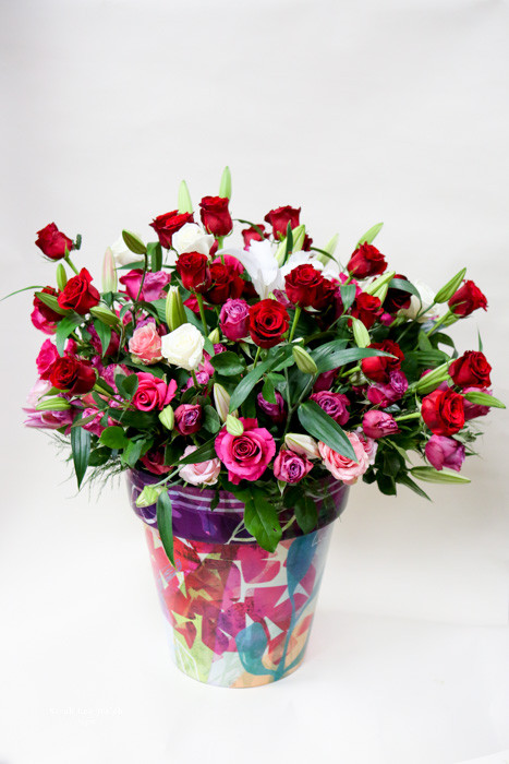 ten dozen roses with lilies arranged in a unique Earle's Fashion. An extraordinary display of beauty with bright colors and the most beautiful smells!