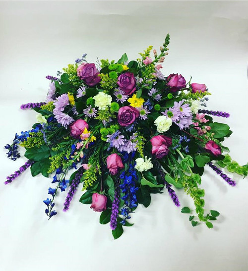 Bold and Beautiful multi color unique sympathy spray with variety of colors and fresh flowers