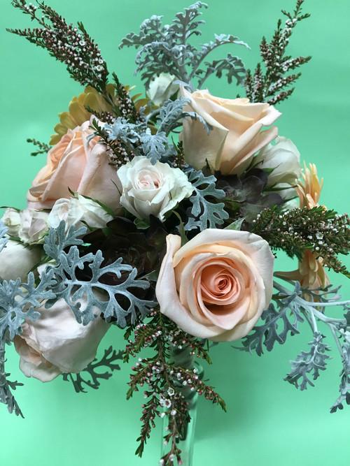 Beautiful Unique Mixed Rose Bridal bouquet designed with  Pastel colors at your Loveland Florist Earle's.
