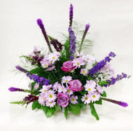 A Bright mix of Dark Purples and soft lavender mixed flowers designed in a one sided sympathy tribute
