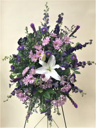 Beautiful mix of lavender and purple fresh flowers designed in a standing easel. Accented with a single local grown white lily!