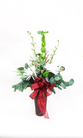 A fun Beautiful variety of winter flowers with a touch of holiday spirit