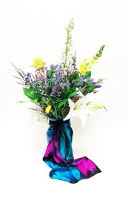 Send her a stunning mix of Spring Flowers designed in a premium vase and add your choice of a earth tone silk scarf or bright silk scarf! Give her the gift of style with these local artist hand painted scarves!