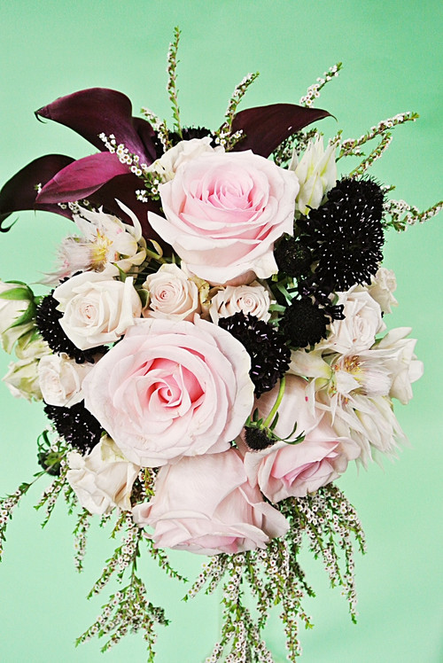 Bold Calla Lilies designed in a variety of roses and other fresh flowers for a awesome cascading Bridal Bouquet. Designed locally at Earle's Loveland