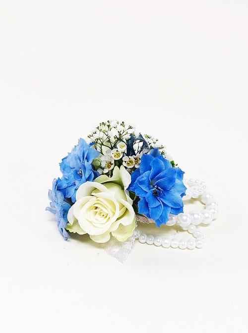 Beautiful Blue and white wrist corsage designed by your Loveland Florist.