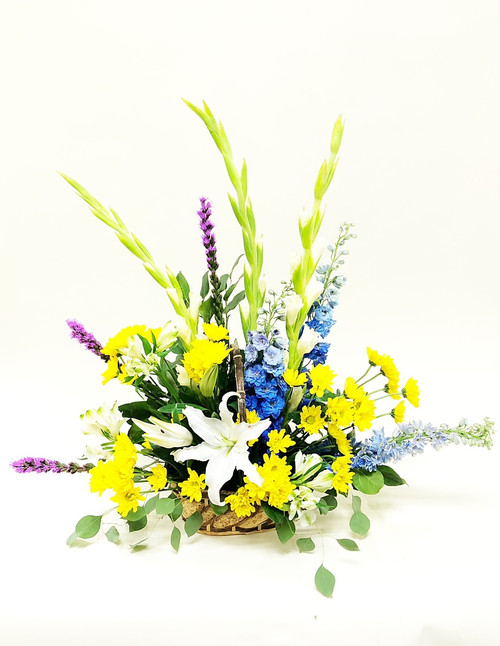 Colors of Colorado in this sympathy tribute yellow blue and white .
