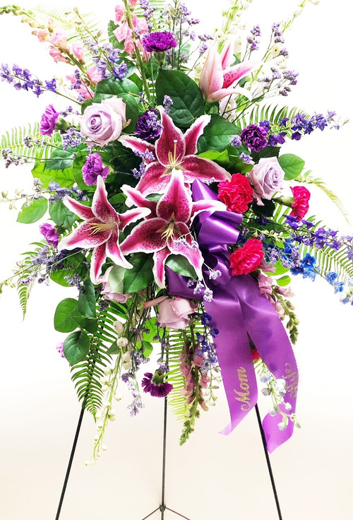 Gorgeous Purple mixed flower sympathy spray with a variety of fresh flowers and colors