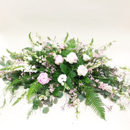large bold simple spray made with beautiful fresh flowers and greens