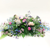 Mixed floral  spray designed locally. bright summer colors make up this beautiful vibrant fresh flower spray