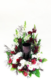 Beautifully intricate and designed with a variety of fresh flowers in red and white. Designed locally at Earle's Loveland.