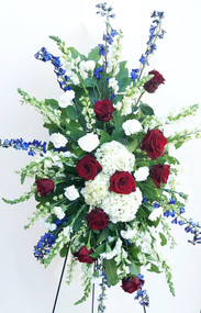 Standing Casket Spray designed with A variety of fresh flowers in red white and blue.