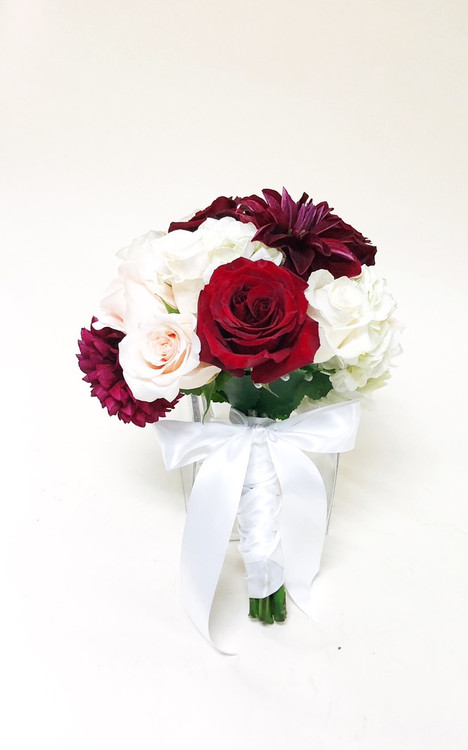 Beautiful shades of red and white in a fresh flower bridal bouquet.