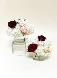 Beautiful shades of red and white in a fresh flower wedding centerpiece cube.