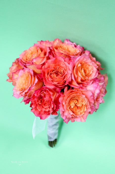 Fresh Flower Bridal Bouquet designed by your Loveland florist Earle's. Beautiful, bright,  orange garden rose  bridal bouquet.