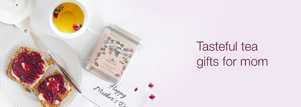 Harney & Sons Mother's Day laid together with a cup of tea and a Mother's Day greeting card