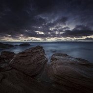 Huge Rocks On The Shore Of A Sea And Stormy Clouds Sardinia Italy