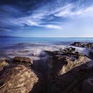 Rocky Shore And Tranquil Sea Portoscuso Sardinia Italy