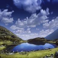 Blue Lake In The Pirin Mountains Over Tranquil Clouds Pirin National Park Bulgaria