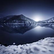 Ritsa Lake In The Snow Covered Mountains Of Ritsa Nature Reserve Georgia