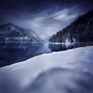 Ritsa Lake In Snow Covered Mountains Of Ritsa Nature Reserve Georgia