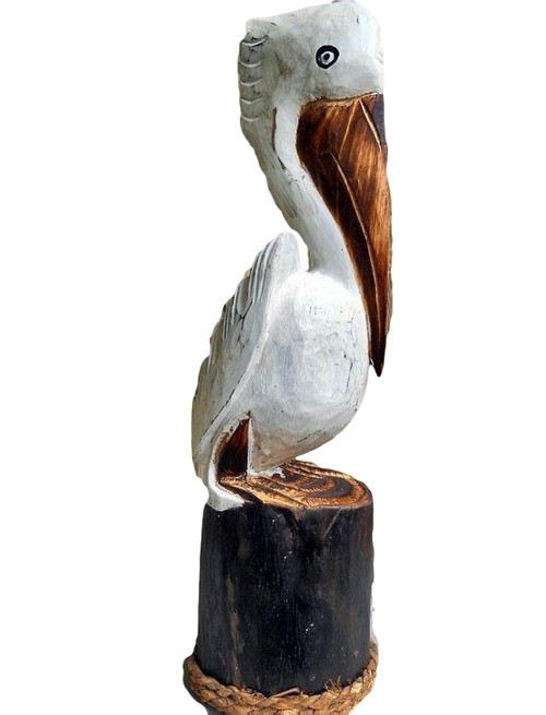 Carved larger White Pelican on a pier post.  Nautical Seasons