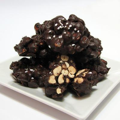 Dark Chocolate Peanut Clusters: Fresh roasted peanuts, lightly salted with sea salt & 60% Dark Chocolate with a sprinkle of sugar pearls and Hawaiian bamboo jade sea salt .