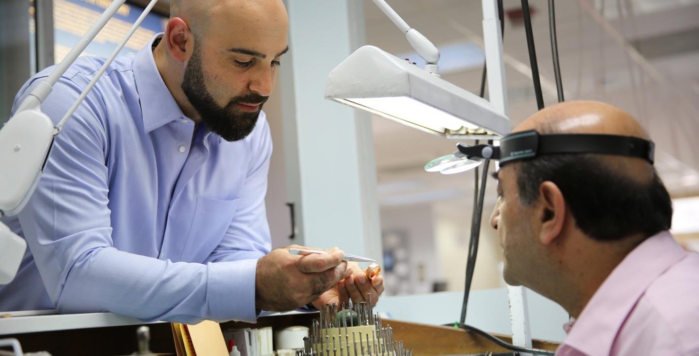 a jewelry craftsman making a diamond ring