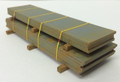 Double stack of plate steel Real wood spacers Yellow strapping