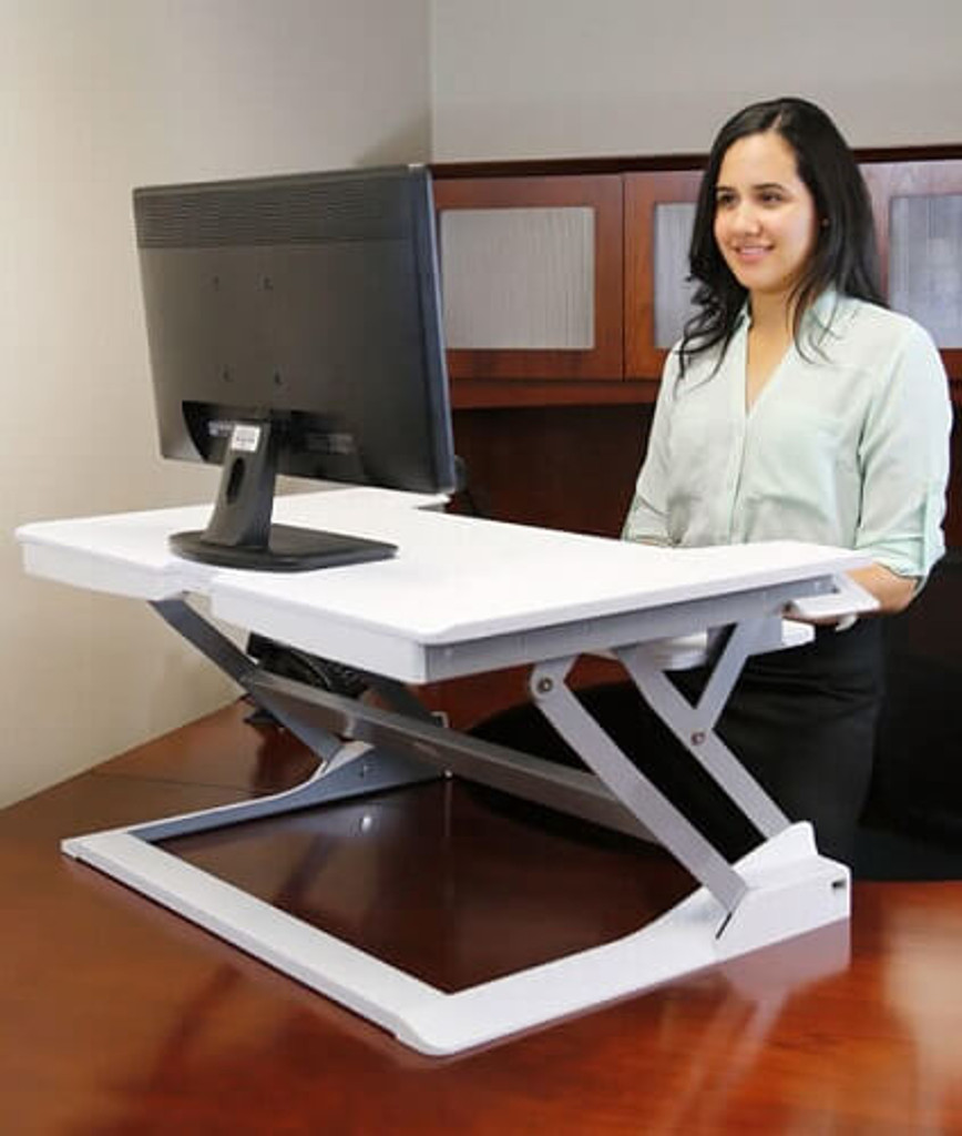 WorkFit-T/TL Sit-Stand Desktop Workstation in use - color white