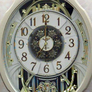Moving Face Pendulum Wall Clock - Plays Melodies Every Hour MWC1984241
