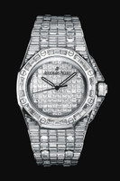 Watches Audemars Piguet Royal Oak Offshore Baguette 15130BC.ZZ.8042BC.01 issued in the case of 18k white gold, size 42 x 54 mm and water resistant to 20 m with a bezel of the white baguette diamonds, encrusted hull white baguette diamonds, total weight of 456, and white baguette diamonds - 47.75 ct. Inside the case is set automatic movement, caliber AR 2325.  The dial with white baguette diamonds displays hours, minutes, seconds. Power reserve 40 hours. Watches are equipped with a bracelet made ​​of white gold 18k, inlaid white baguette diamonds.