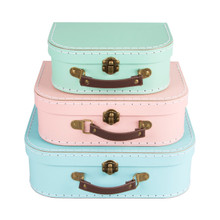 Dimension - 29 x 20 x 9 / 25 x 18 x 8 / 20 x 15 x 8 cm •Material - Cardboard, Metal, Faux Leather •Colour - Pink, Blue, Green  A stylish and pretty take on our classic suitcases. These brand new pastel shades are perfect for cute and subtle storage.   The three boxes tidy away inside each other and when filled show the three pastel colours; pink, blue and green. The little fixings are made out of brass and the handle is made out of leatherette