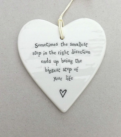 Porcelain Hanging Heart- ' Sometimes the smallest step in the right direction ends up being the biggest step of your life'.     This would make an ideal gift for someone who you consider to be someone special! It's a perfect little decoration to place with pride in the home for an ultimate source of inspiration to move forward in life.  It is a beautiful gift or decoration for anywhere around the home or to gift to someone special in your life. It can be gifted to the love of your life or friends to a beautiful piece of inspiration.   It can be gifted at any occasion like festival, birthday, anniversary or farewell.     The heart comes with twine string attached and is engraved with the words 'Sometimes the smallest step in the right direction ends up being the biggest step of your life'.  A perfect gift for any occasion!  Package Dimensions: 23.8 x 10 x 2.2 cm Material: Ceramic
