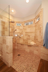 Level Entry Shower Waterproofing System Tile Shower next to Wood Flooring