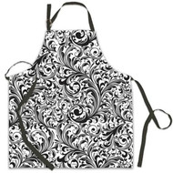 Black adjustable neck strap and black waist ties, large size apron covered in black/white lacy design.