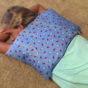 Microwave Corn Heating Pad on the upper back - helpful for physical therapy